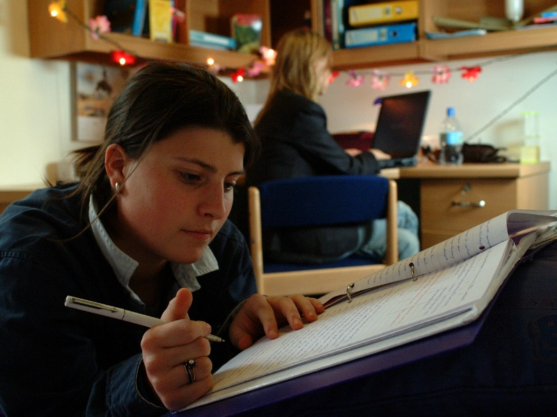 girl studying in a dorm at Priors Field School